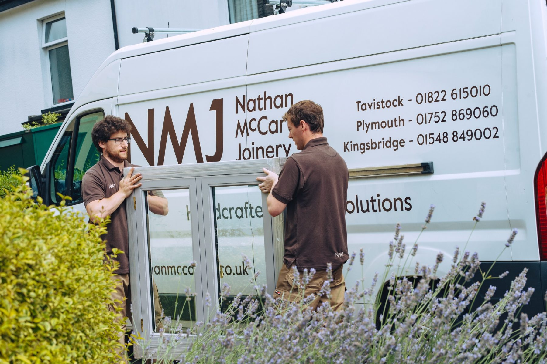 The Nathan McCarter team ready to install bespoke timber windows