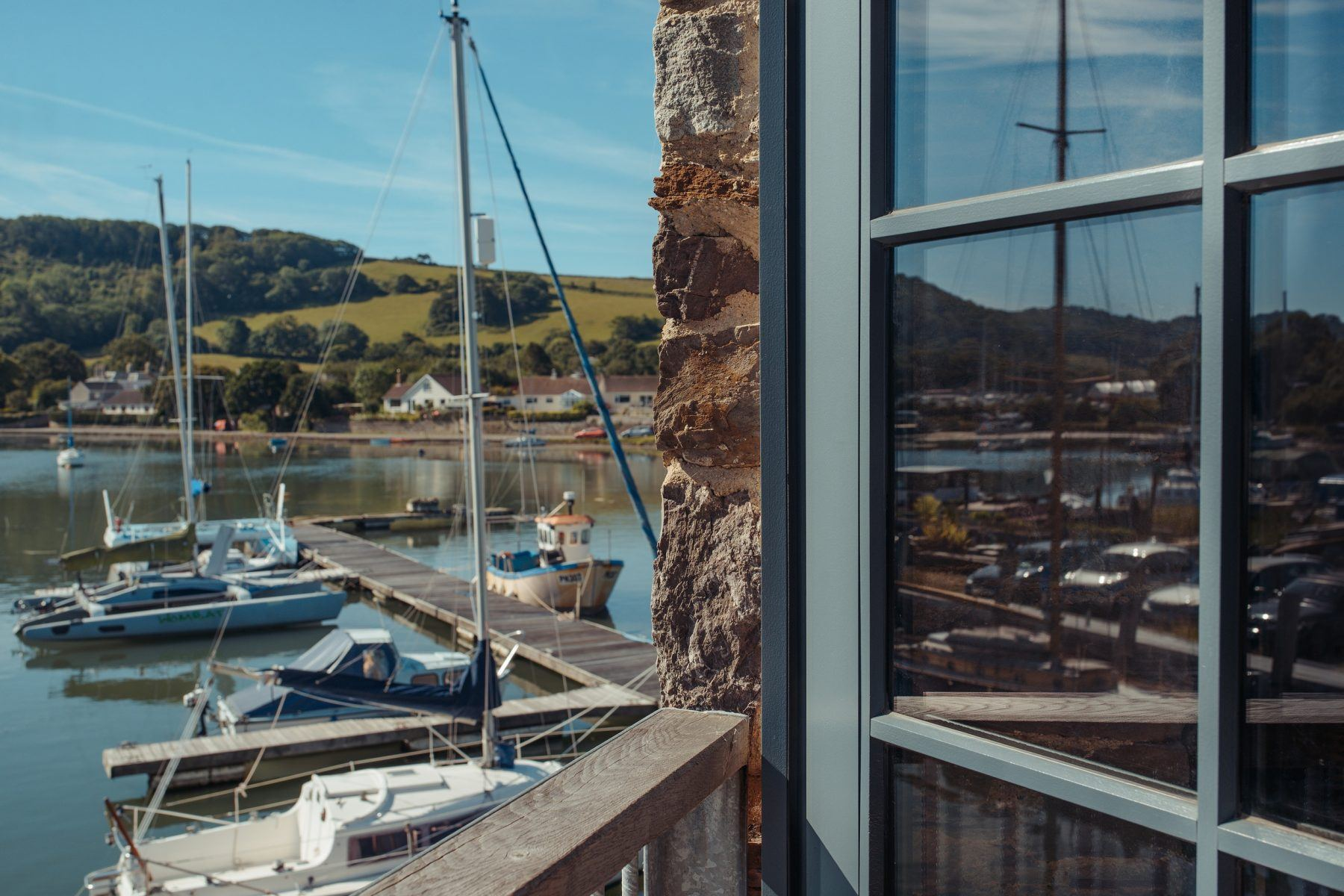 bespoke timber double doors looking out on harbour