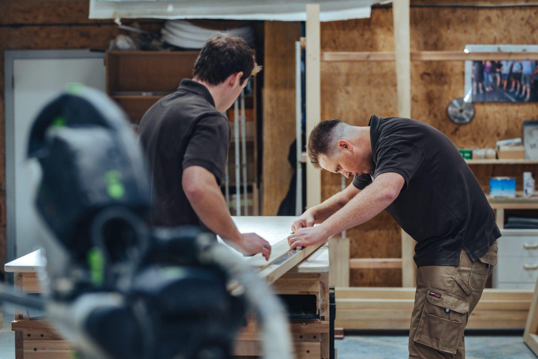 Nathan McCarter measuring a timber door