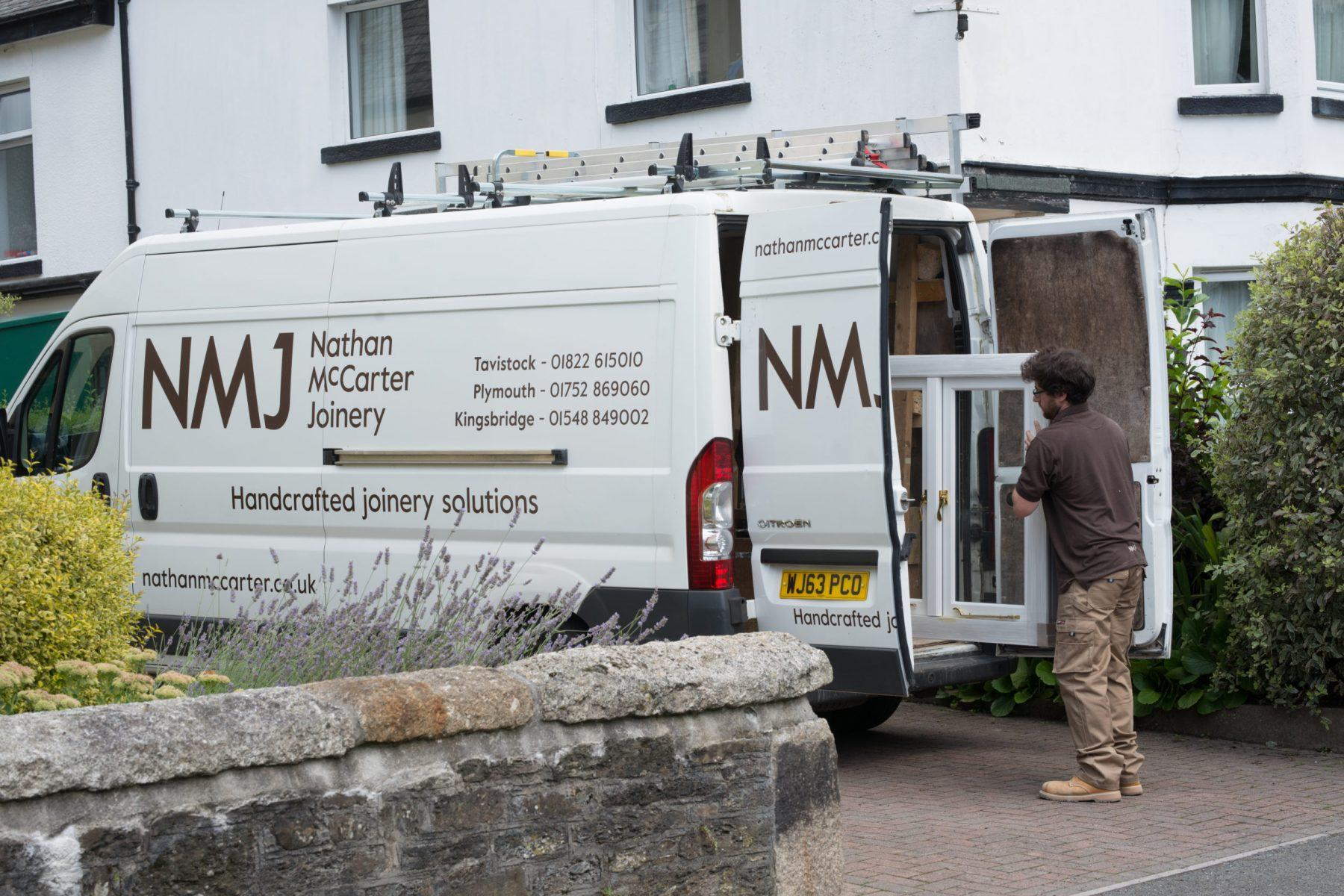Nathan McCarter staff delivering a bespoke timber window made with Accoya wood
