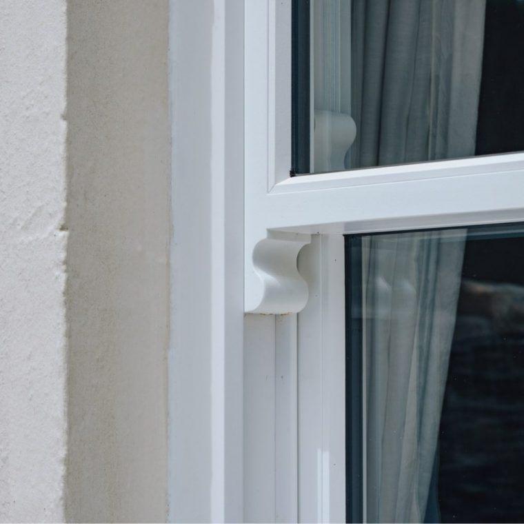 white sliding sash window detailed view