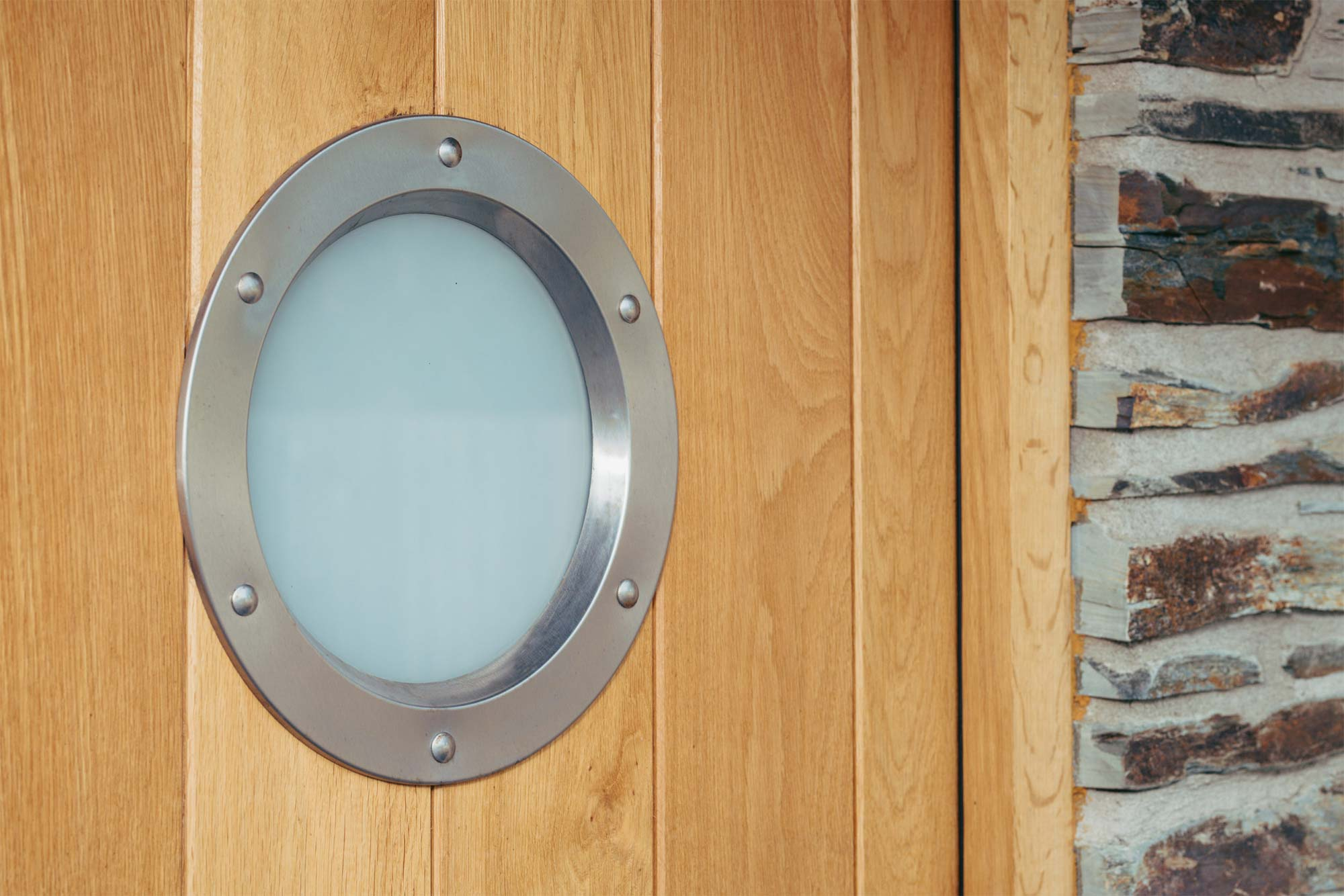 bespoke timber door with porthole