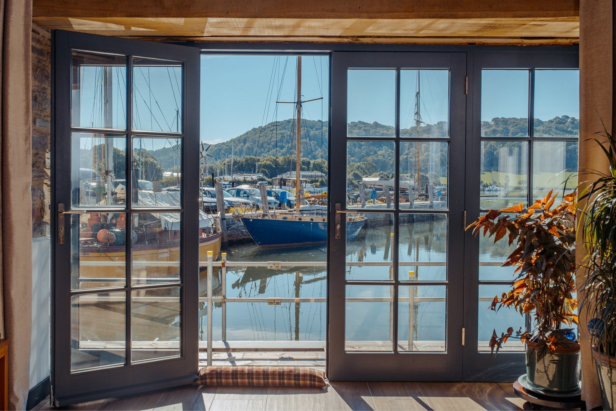 bespoke timber double doors by the sea