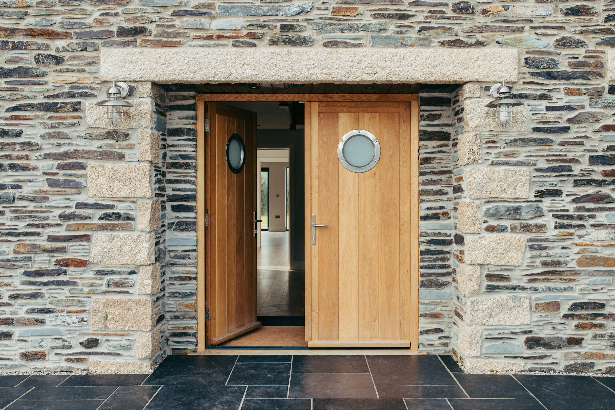 bespoke timber double front doors with portholes
