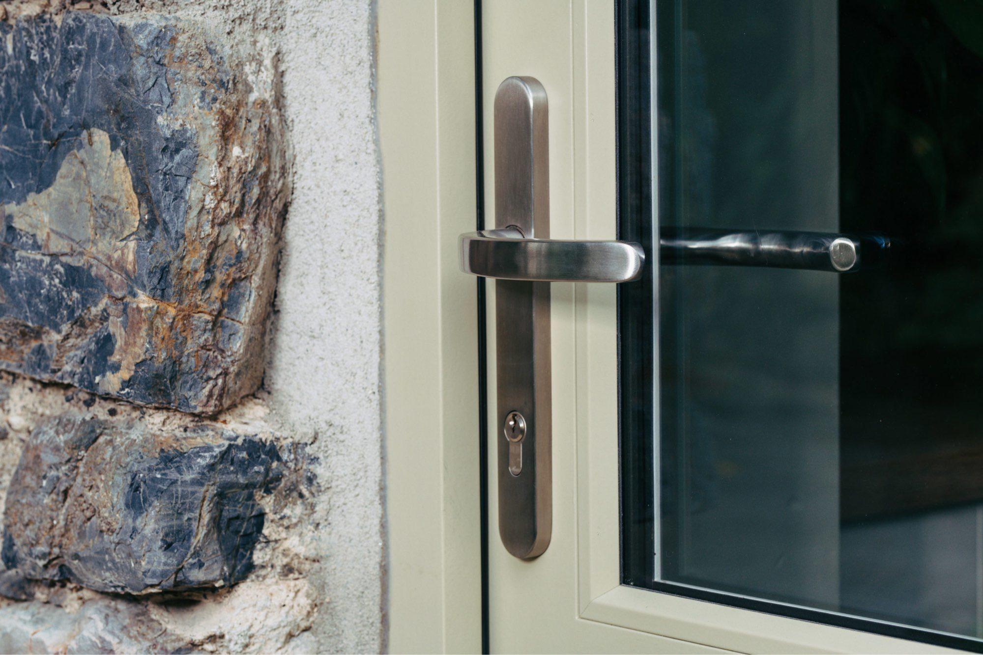 close up of bespoke wooden door handle