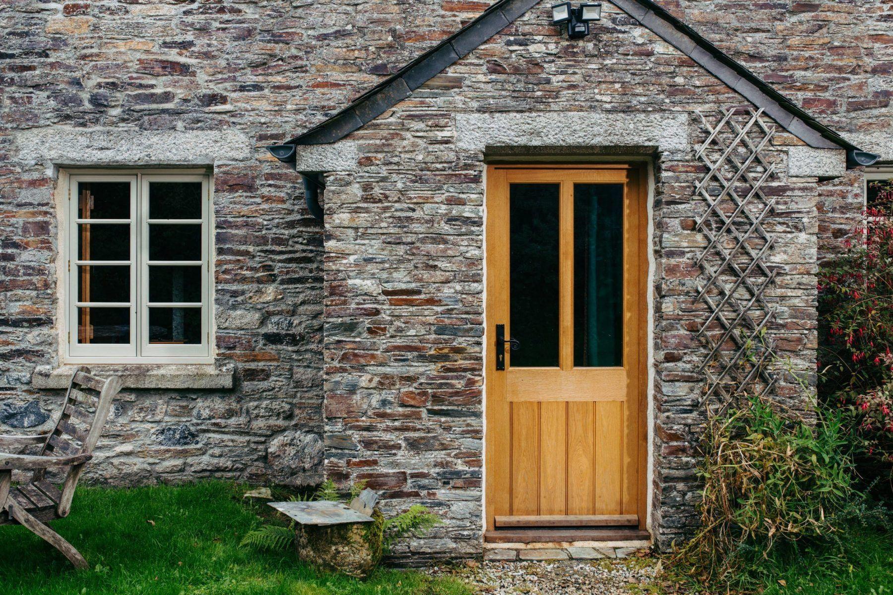 custom timber door on cottage porch